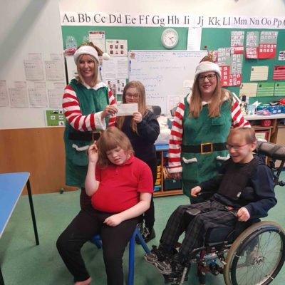 McLeods handed over a cheque for £500 to Fairview School