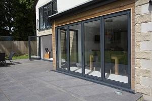 Bi fold doors opening facing onto back garden of property