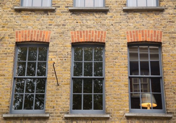Sash and Case windows With lamp sitting inside