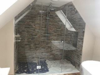 A glass showering enclosure