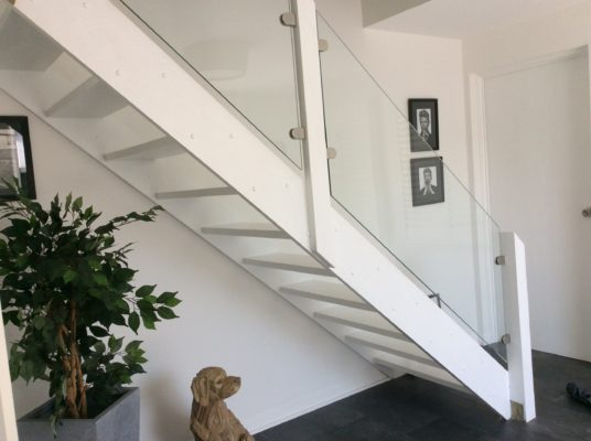 White stairs and glass balustrade