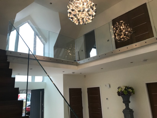 Glass banners and balustrades within a domestic property
