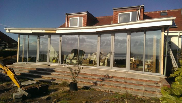 Large glass bi folding doors on an extension
