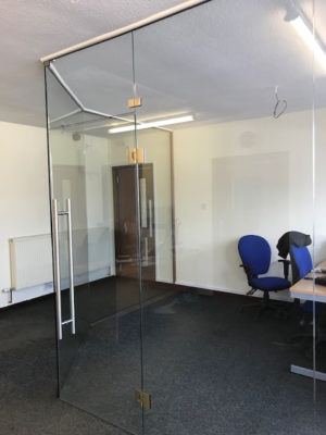 Glass wall partitions in modern office