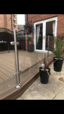 Stainless steel glass balustrades with composite wood decking